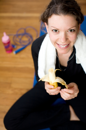Exercising Woman Eating Banana