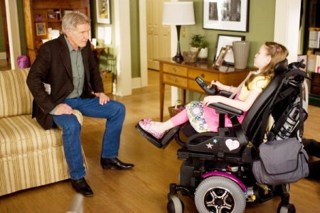 Harrison Ford visits with a child he's trying to save in Extraordinary Measures
