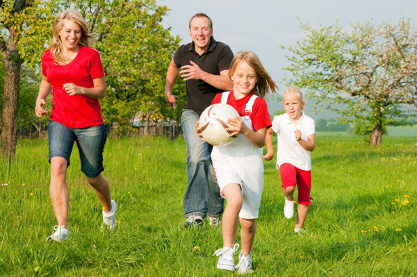 Family Running with Soccer