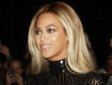 French media thinks Beyoncé is riding Obama's surfboard