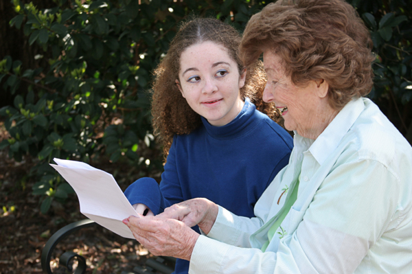 Girl Reading to Older Woman