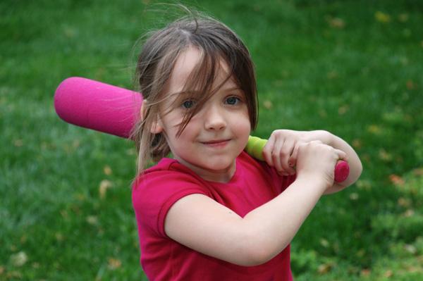 Girl with pink baseball bat