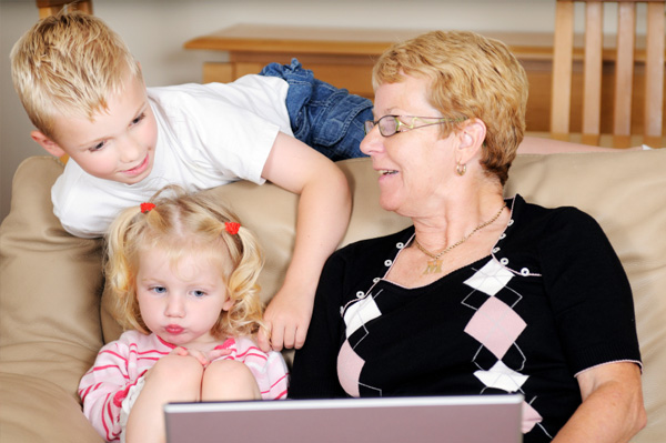 Grandma with kids on computer