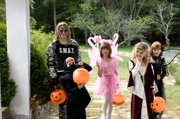 Group of tweens trick or treating