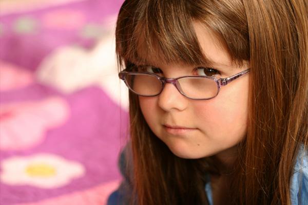 Grumpy Girl wearing Glasses