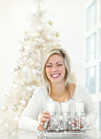 Happy woman with Christmas Candles and Treet