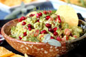 Add a dash of pomegranates and herbs for an 'I love fall' guacamole