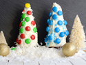 Candy-coated ice cream cone Christmas trees with a sweet surprise inside