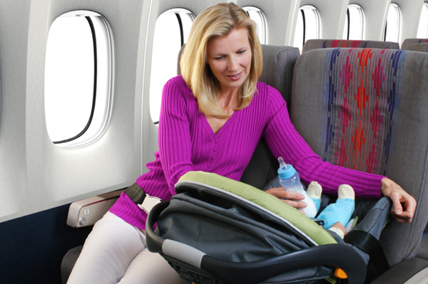 Infant in car seat on plane