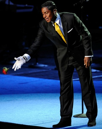 Jermaine Jackson accepts a rose from a fan