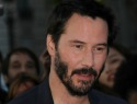 Keanu Reeves comes face-to-face with an intruder in his home