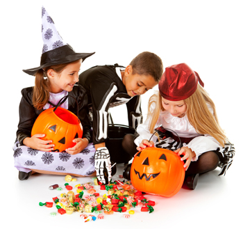 Kids examining Halloween Candy