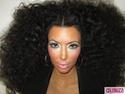 Kim Kardashian sports afro, heavy makeup, for photo shoot