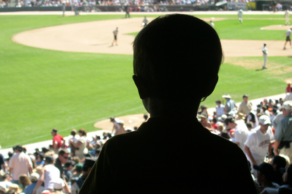 Little boy at baseball game