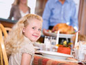 Little Girl at Thanksgiving Table