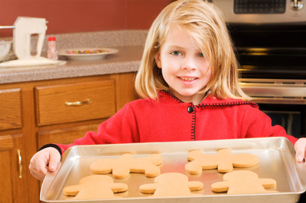 Little Girl Holding Christmas Cookies
