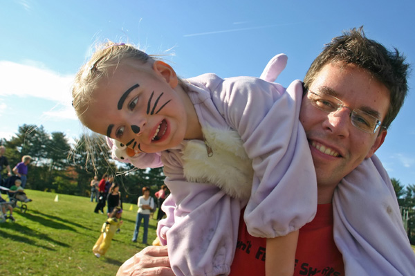 Little girl in rabbit costume on father