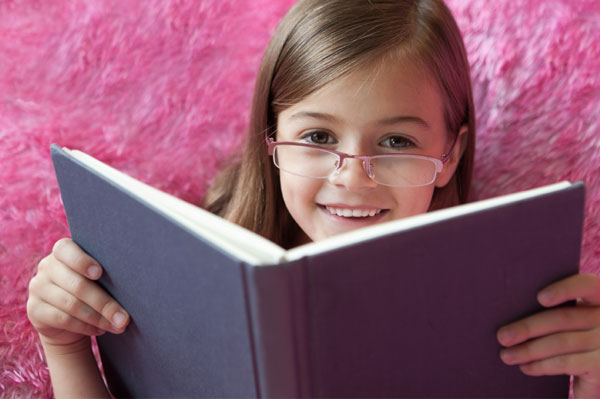 Little Girl wearing pink glasses