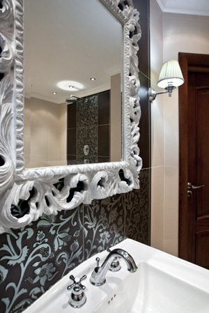 Master bathroom with framed mirror