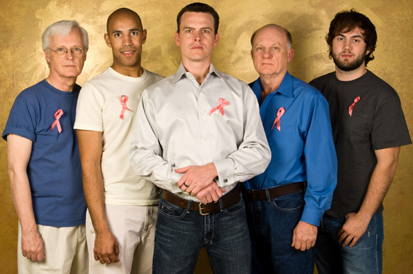 Men wearing breast cancer ribbon