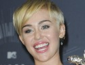 Miley Cyrus stands by her troubled VMAs date
