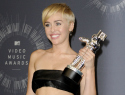 Miley Cyrus' VMAs date turns himself in to police