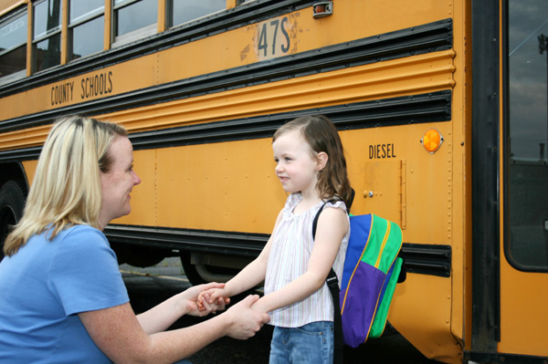 Mom and Daughter at School Bus