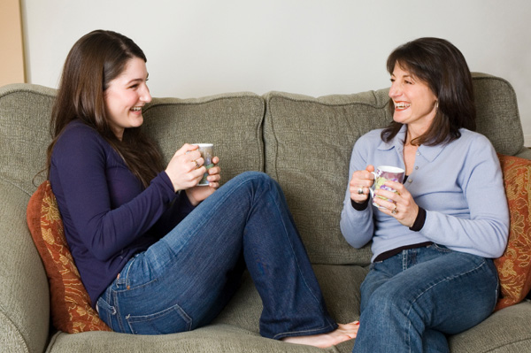 Mom having coffee and chat with teen