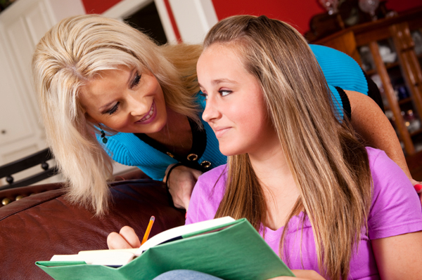 Mom with tween girl doing homework