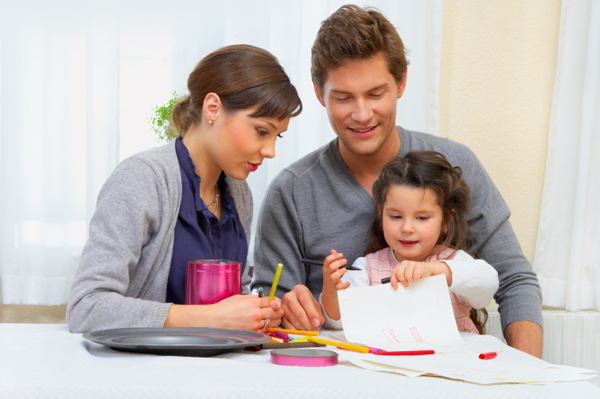 Mother and father drawing with child