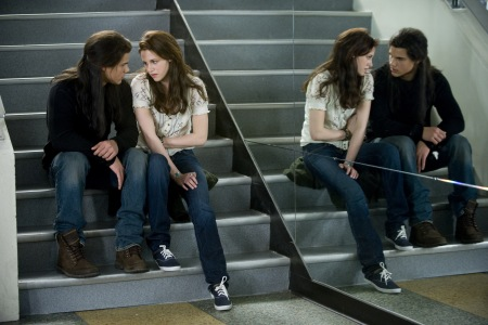 Kristen Stewart and Taylor Lautner share a moment in New Moon