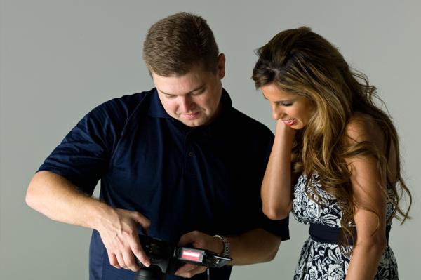 Photographer hugging woman