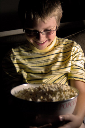 Boy eating popcorn