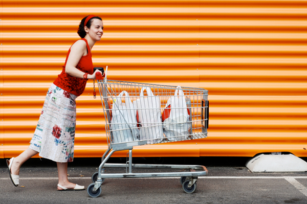Pregnant woman with shopping cart