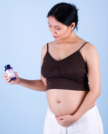 Pregnant Woman with Vitamins