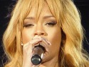 Rihanna whacks grabby fan with microphone during concert