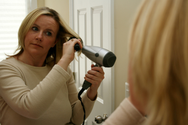 Woman with Round Brush and Blow Dryer