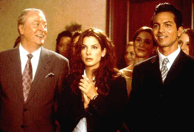 Michael Caine, Sandra Bullock and Benjamin Bratt share a laugh