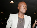 Seal postpones music tour