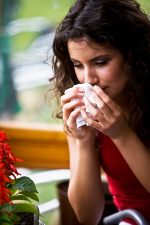 woman tissue cold flu sneeze allergies