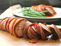 Spice-rubbed pork tenderloin wrapped in bacon
