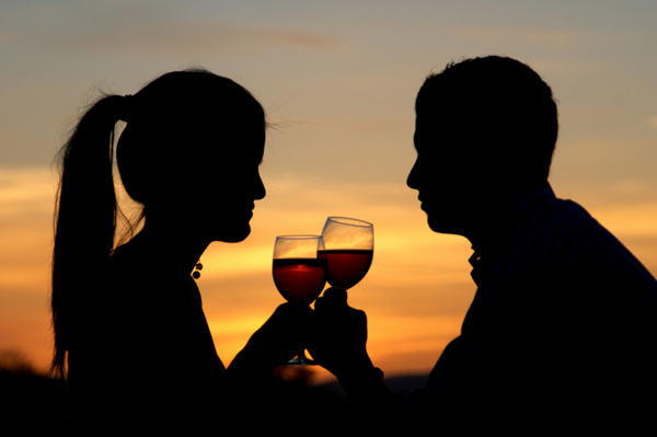 Couple Drinking Wine at Sunset