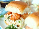 Sweet & spicy shrimp sliders piled high with creamy cole slaw