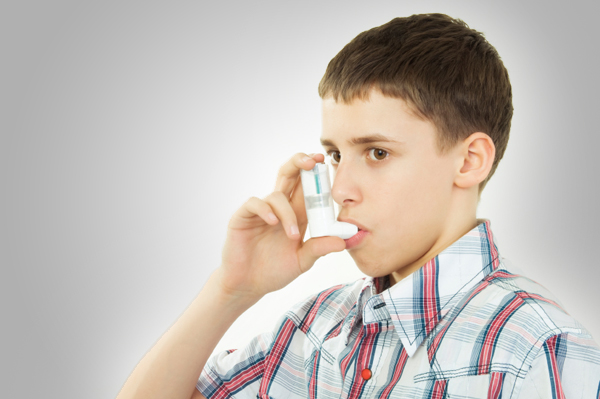 Teen with inhaler