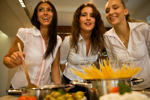 Three Woman Cooking Together
