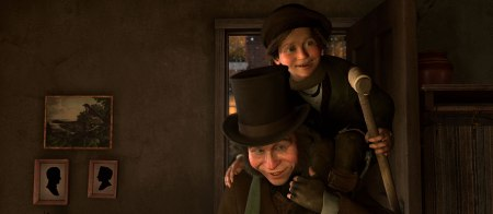 Gary Oldman carries Tiny Tim in A Christmas Carol