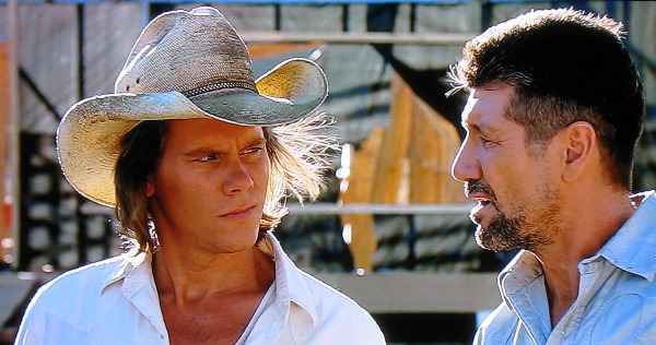 Kevin Bacon and Fred Ward prepare to do battle
