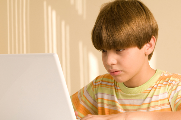 Tween boy on computer