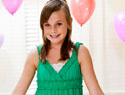 Tween girl at birthday party