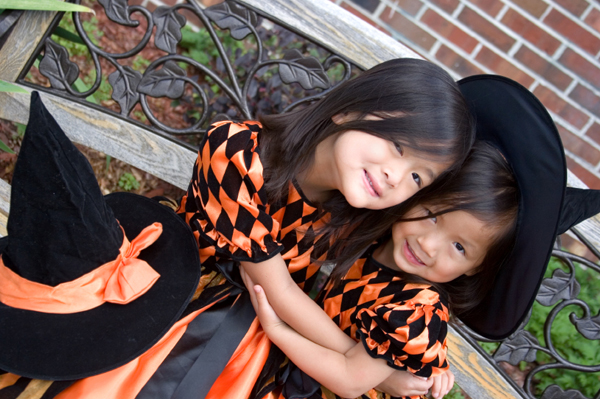 Two girls dressed up like witches
